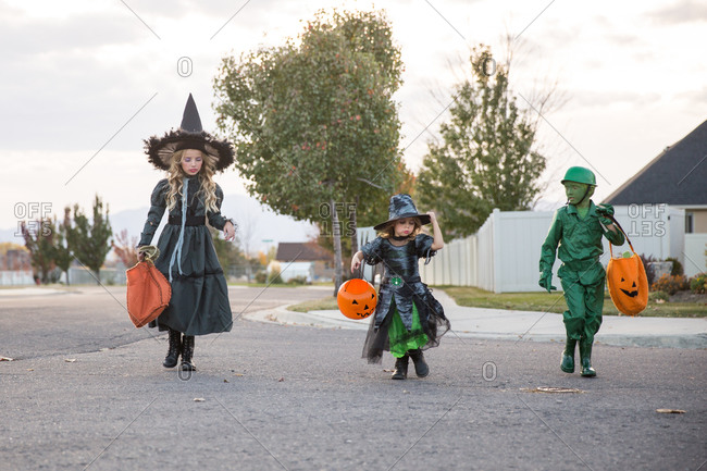 Kids dressed as witches and toy soldier