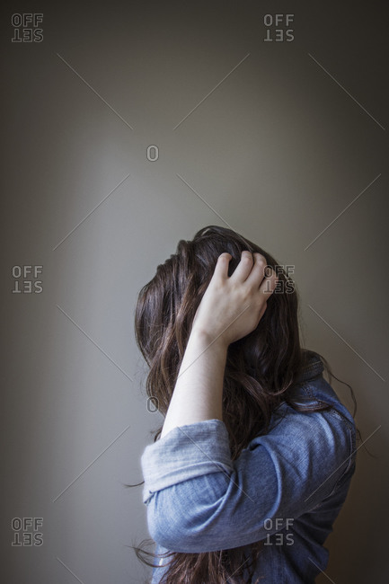 Woman scratching her head