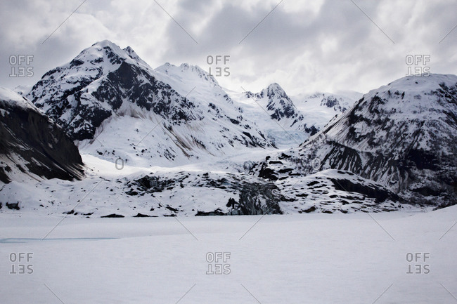 Barren landscape of snow and mountain peaks