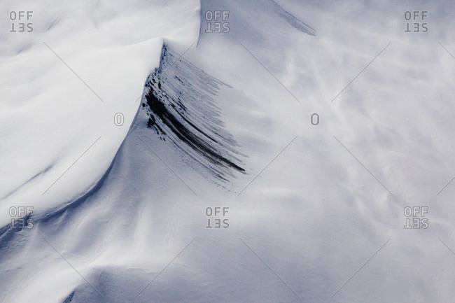 Aerial view of a mountain ridge in blowing snow