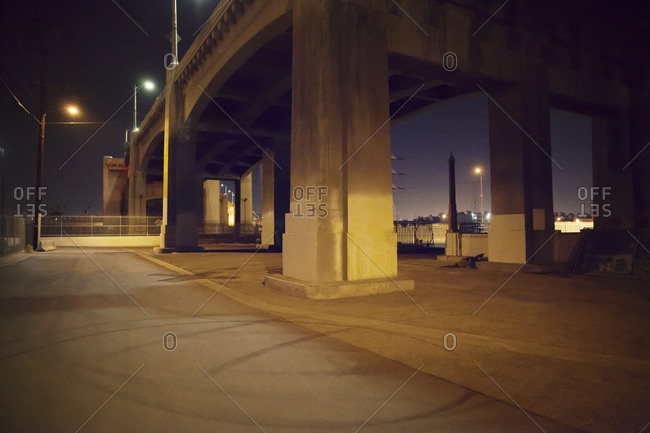Beneath a highway overpass at night