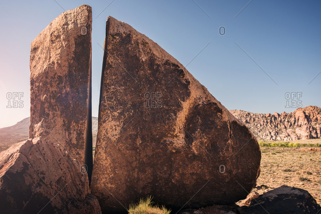 Boulder with a split in desert landscape