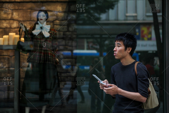 Nagoya, Japan - September 23, 2015: A man in front of a store window