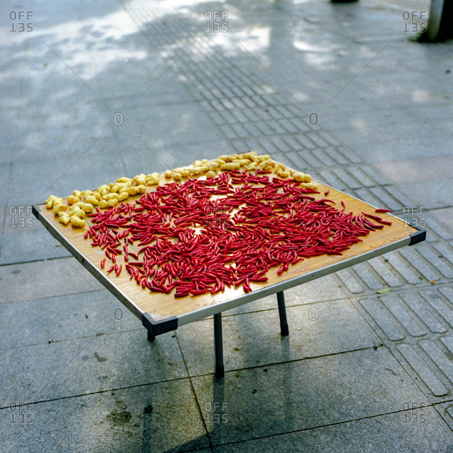 Ginger and chili peppers on a table outside in Ji'an, China