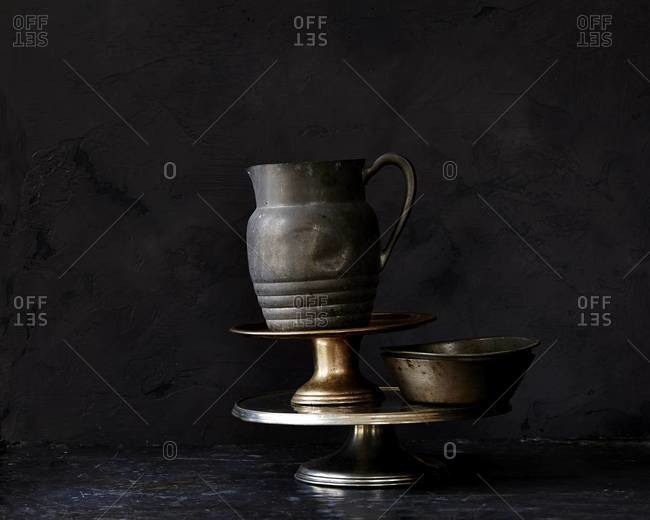Metal pitcher and food stands