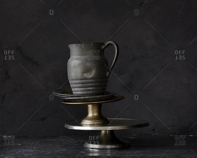 Metal pitcher, plates and food stands