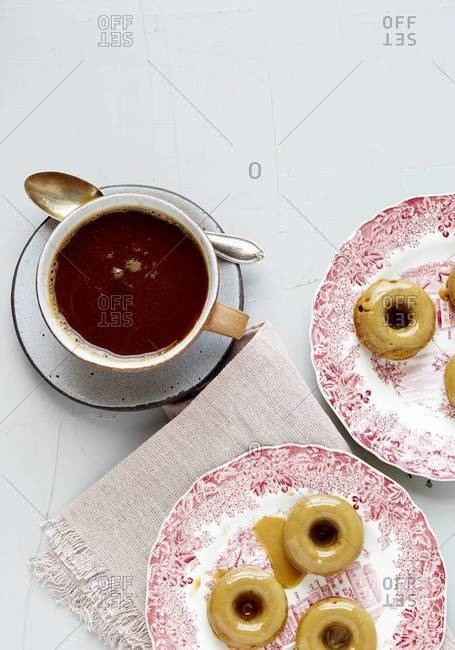 Molasses doughnuts and a cup of coffee