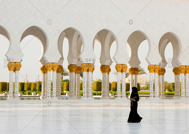 Abu Dhabi, UAE - September 14, 2012: A woman at the Sheikh Zayed Mosque in Abu Dhabi