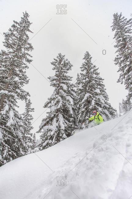 Man skiing deep powder in St. Anton, Austria