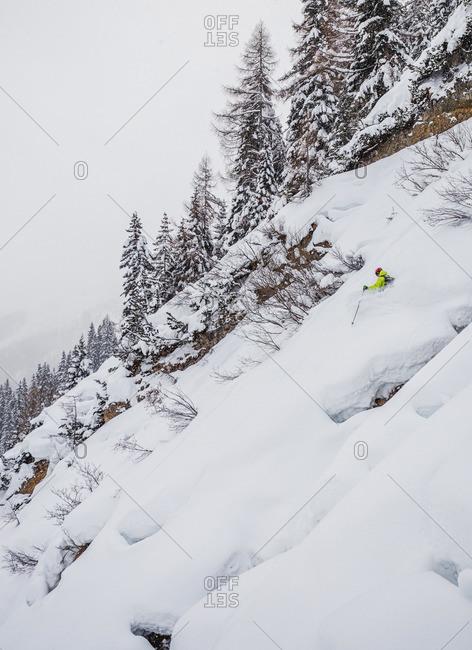 Man skiing powder in St. Anton, Austria