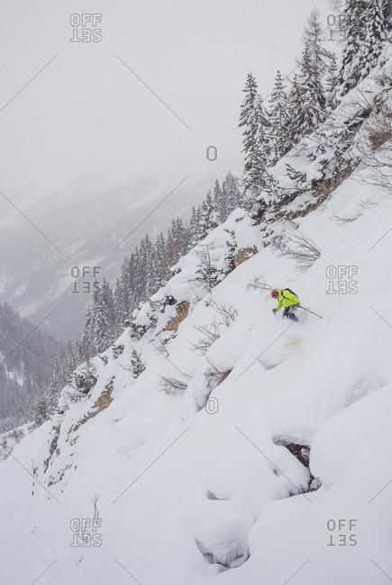 Man skiing powder snow in St. Anton, Austria