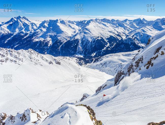 Man skiing on powder snow in St. Anton, Austria