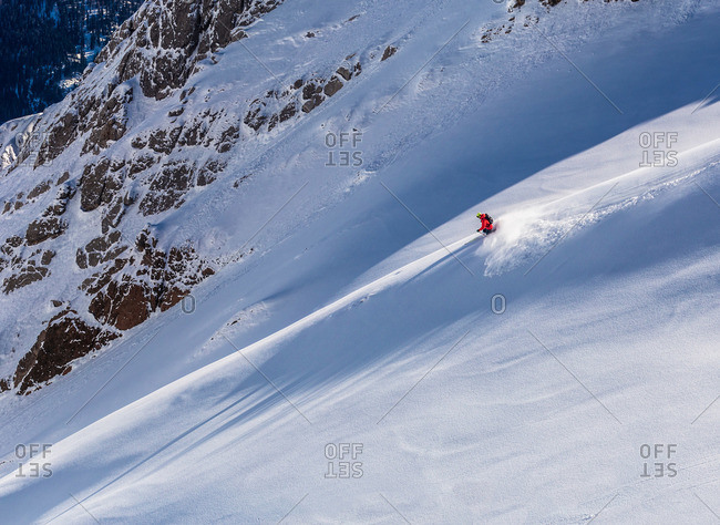 Downhill skier on powder snow in St. Anton, Austria