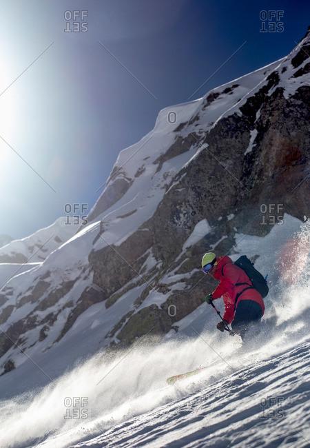 Man skiing on a steep rocky mountain