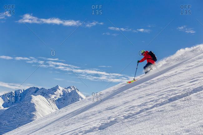 Man powder skiing in St. Anton, Austria