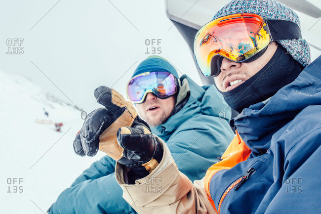 Two skiers on a ski lift together