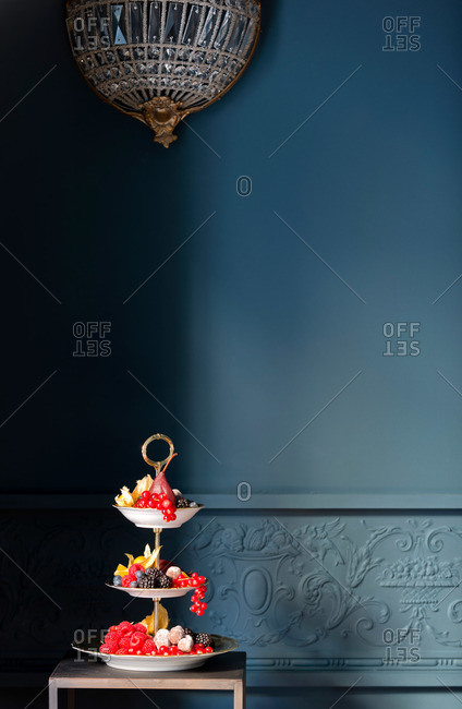 A fruit tray in a blue room