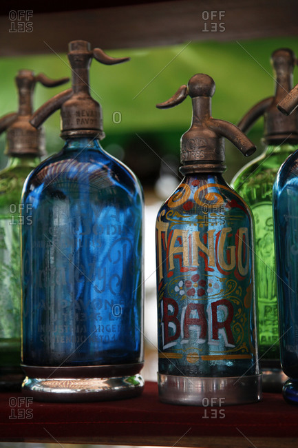 Glass soda siphons for sale at a market