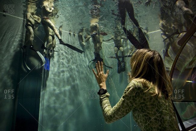 Padua, Italy - December 9, 2014: Woman watching swimmers in Y-40 from an underwater tunnel