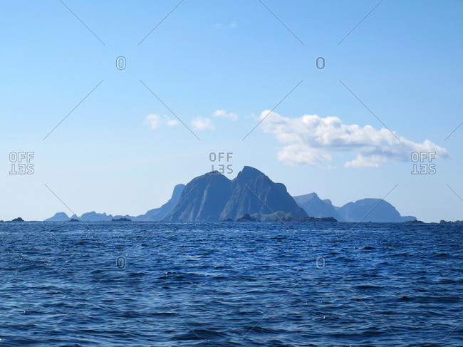 Distant island mountains across a blue sea