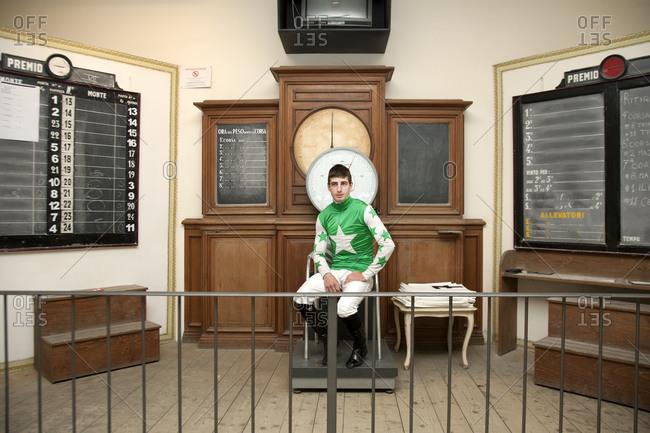 Jockey sitting on a scale