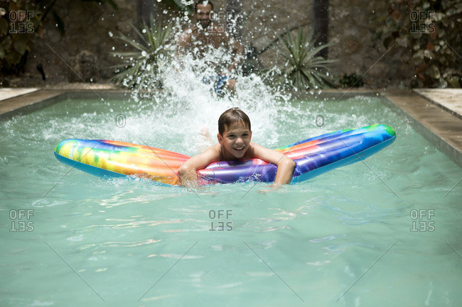 Boy swimming with inflatable pool floatie