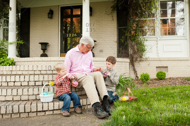Grandfather and grandsons with Easter baskets