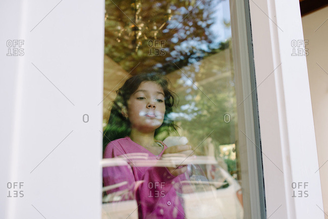 Girl cleaning windows at her house