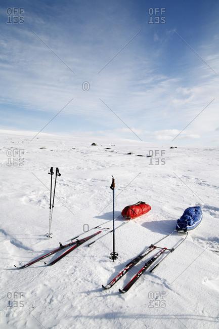 Skis and toboggan
