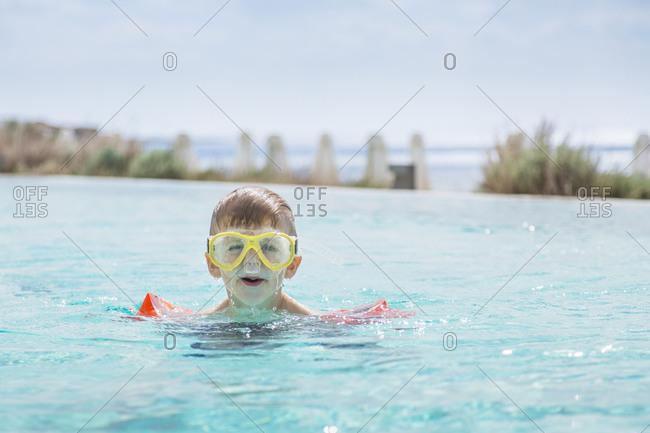 Boy swimming in swimming-pool