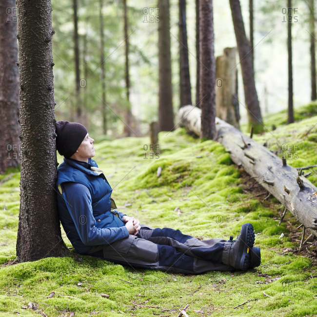 Man relaxing in forest