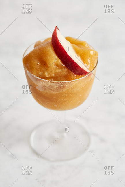 Peach sorbet with a peach slice on top