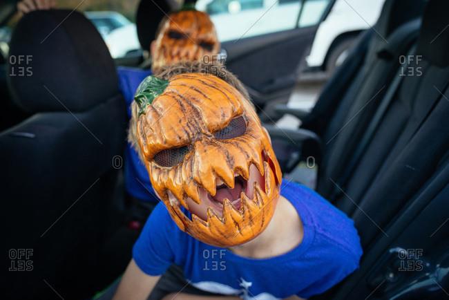 Children wearing scary pumpkin masks