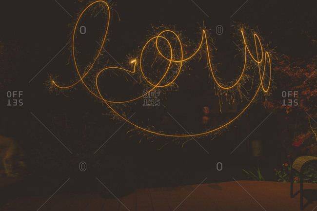 The word love spelled out with a sparkler