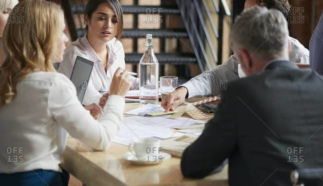 Business people holding a meeting at a conference table
