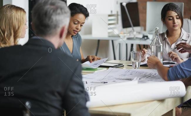 People having a business meeting at a conference table