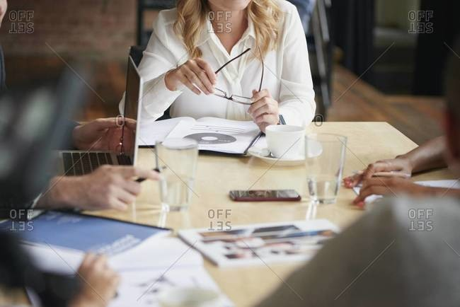 People sitting around a conference table having a business meeting
