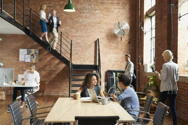 People working in a busy modern office