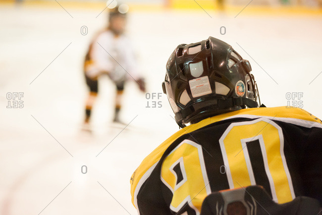 Boys playing ice hockey