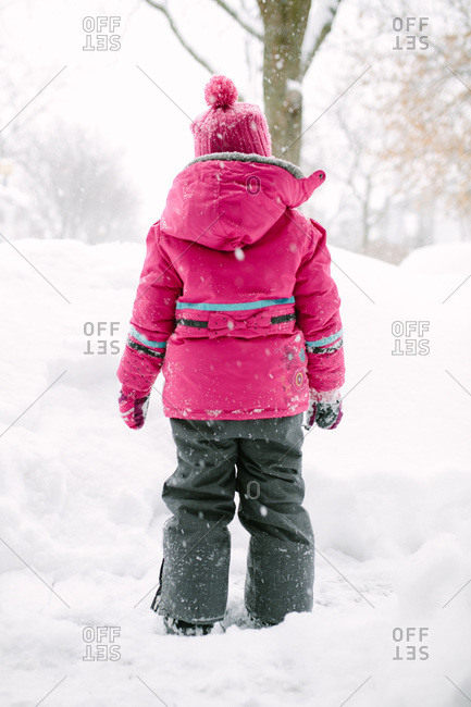Girl in winter gear standing in the snow