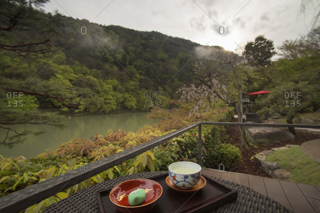 Tea served on a balcony facing a peaceful river
