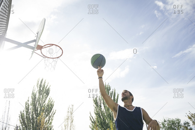 Man spinning a basketball on his finger