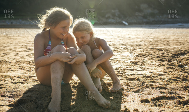 Two sisters having fun together on the beach