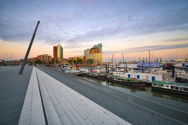 Hamburg, Germany - September 8, 2015: Elbphilharmonie and harbor in the evening, Hanseatic Trade Center