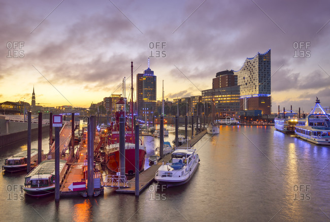 Hamburg, Germany - September 10, 2015: View to harbor with Hanseatic Trade Center and Elbphilharmonie in the background