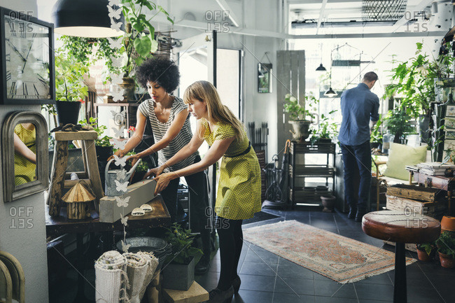 Male and female colleagues working in an interior design shop