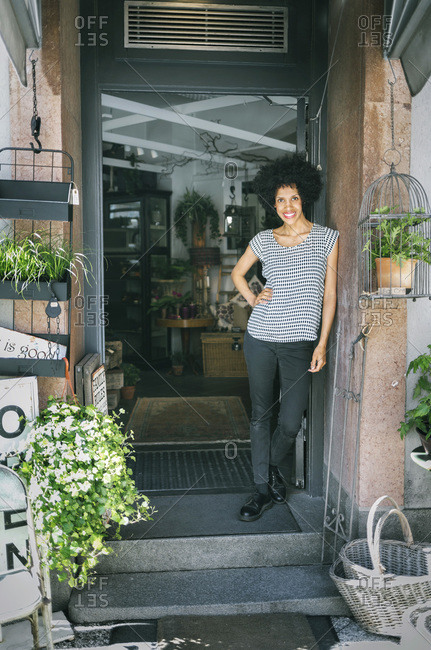 Portrait of confident store owner standing outside store