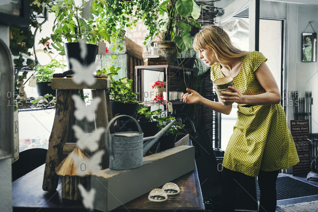 Mid adult woman working in an interior design shop