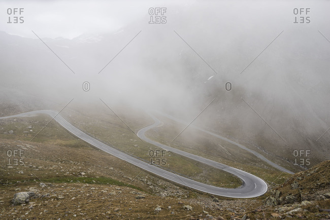 Desolate road on a foggy mountain