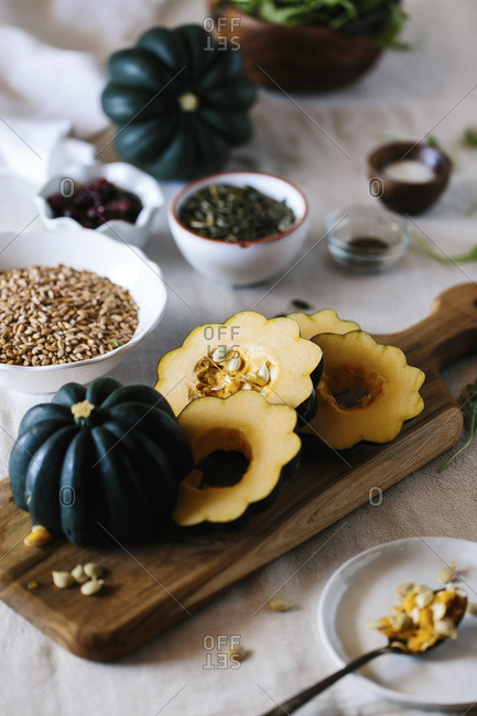 Ingredients for roasted acorn squash salad on a table